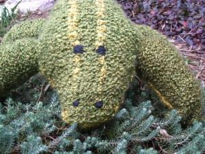 Close-up view of large knitted plush alligator